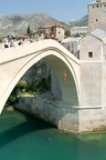 Tourists watching at people who jump from the famous bridge of Mostar