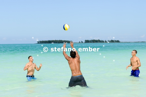 People playing volleyball in clear water of Cayo Guillermo beach
