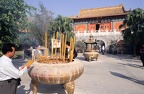 Buddhist believers burn incense in front of Po Lin Monastery