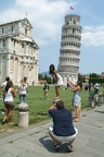 Tourists visiting the leaning Tower and Cathedral of Pisa