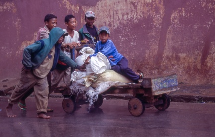 Boys pushing an old cart at Ambositra