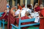 Monks reading newsparers at the  Shwe in Bin Kyaung monastery of Mandaley
