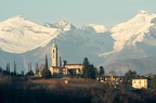 The church of Sant Abbondio at Gentilino in front of the Swiss alps